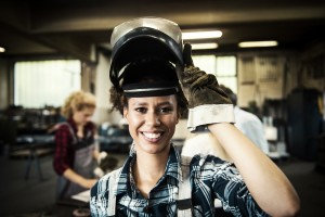 Female Welder in a Metal Shop